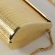 Pochette gioiello in metallo dorato